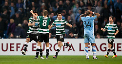 MANCHESTER, ENGLAND - Thursday, March 15, 2012: Sporting Clube de Portugal's Emiliano Insua, Ricky van Wolfswinkel and Stijn Schaars celebrate their side's 3-2 defeat to Manchester City, meaning that they are through to the next round, as Manchester City's Nigel de Jong looks dejected after the UEFA Europa League Round of 16 2nd Leg match at City of Manchester Stadium. (Pic by Vegard Grott/Propaganda)
