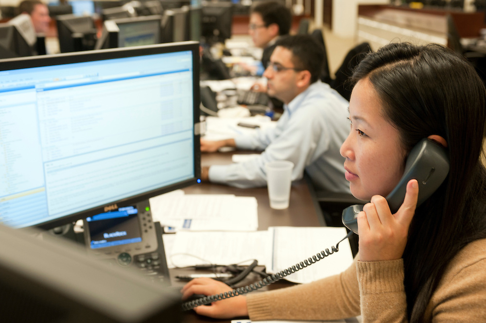 Trading Floor at BlackRock. Vice president Di Wang on the phone with a client...BlackRock headquarters on 52nd street in Manhattan, New York City..Blackrock is the world's largest money managing company. According to Fortune magazine 'With more than $3 trillion in assets, Larry Fink and his team at BlackRock are the world's largest money managers'.