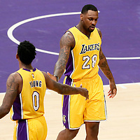 31 January 2017: Los Angeles Lakers guard Nick Young (0) celebrates with Los Angeles Lakers center Tarik Black (28) during the LA Lakers 120-116 victory over the Denver Nuggets, at the Staples Center, Los Angeles, California, USA.