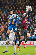 Wolverhampton Wanderers goalkeeper John Ruddy (21) prevents a header from Shrewsbury Town's Josh Laurent during the The FA Cup fourth round match between Shrewsbury Town and Wolverhampton Wanderers at Greenhous Meadow, Shrewsbury, England on 26 January 2019.