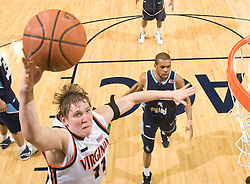 Virginia forward Laurynas Mikalauskas (11) shoots a jump shot beating Old Dominion guard Brandon Johnson (4) to the basket. The Virginia Cavaliers men's basketball team defeated the Old Dominion Monarchs 80-76 in the second round of the College Basketball Invitational (CBI) at the University of Virginia's John Paul Jones Arena in Charlottesville, VA on March 24, 2008.