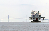A 96-year-old Victorian home made a 25 mile voyage across Tampa Bay from Bradenton, Florida to Ruskin, Florida.  The 7,000 square foot home crossed under the Sunshine Skyway Bridge.