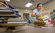 Megan Ryan sorts books for her 4th grade class in preparation of the first day of school at Horn Elementary School, August 19, 2014.