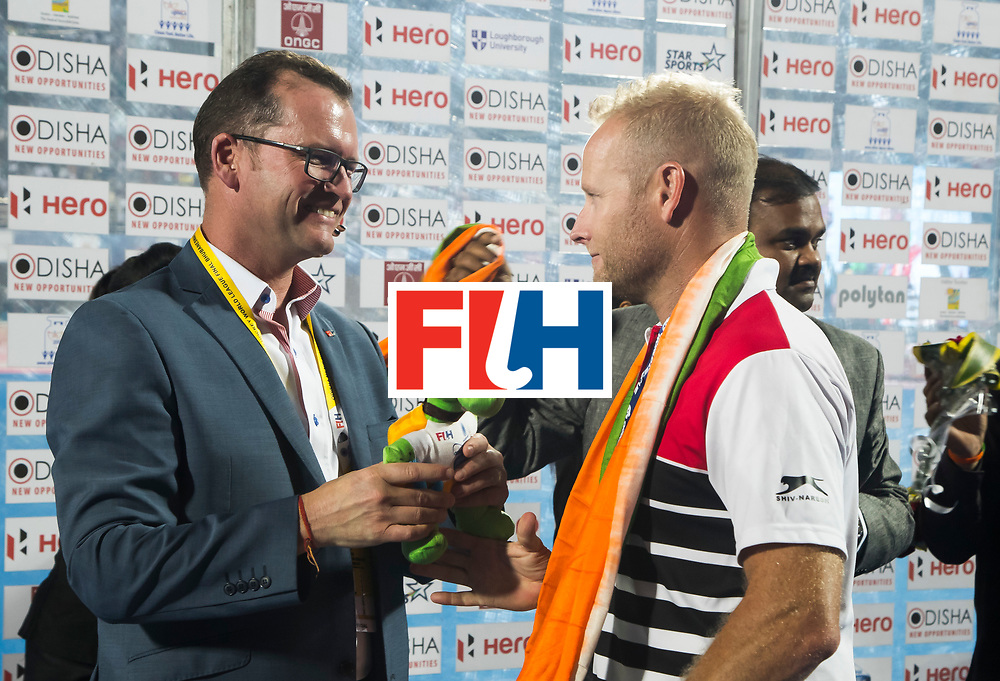 BHUBANESWAR - Hockey World League finals Match for bronze , Germany v India (1-2). Jason McCracken. CEO Chief Executive Officer with coach Sjoerd Marijne (Ind)COPYRIGHT KOEN SUYK