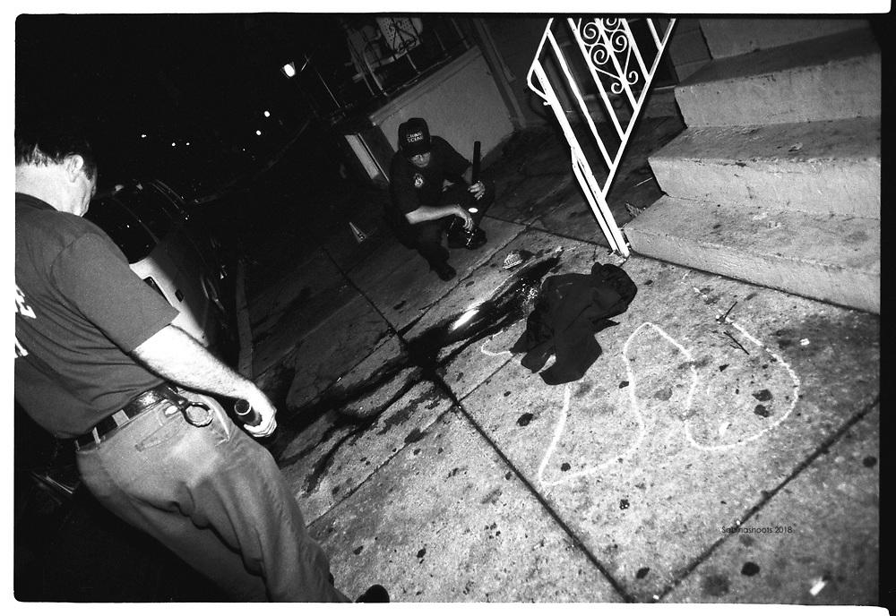 Crime scene unit cops examine a drive by shooting scene in Phialdelphia