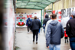 A general view of a 'We March On' sign as fans walk through an overpass leading to St Marys Stadium prior to kick off - Mandatory by-line: Ryan Hiscott/JMP - 12/08/2018 - FOOTBALL - St Mary's Stadium - Southampton, England - Southampton v Burnley - Premier League