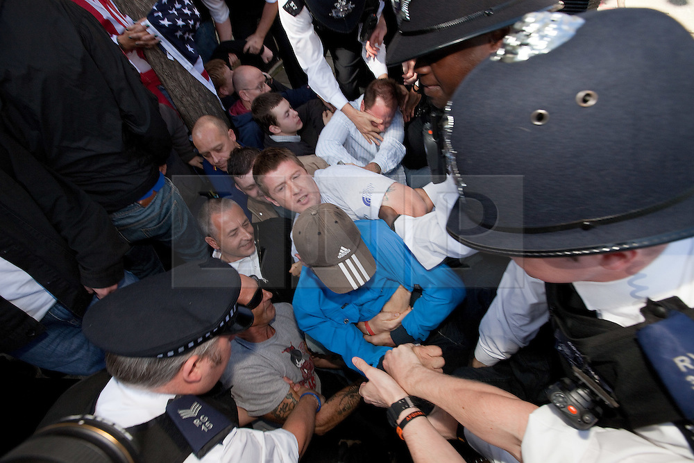 © Licensed to London News Pictures. 11/09/2011. London, UK. EDL supporters occupying the space designated for the MAC demo as police try to move them on, in advance of the MAC demo. Radical Islamist group, Muslims Against Crusades, hold a protest outside the US Embassy in Grosvenor Square, London, on the 10th anniversary of the September 11th terrorist attacks on America. A counter-protest was held at the same time by the English Defence League. Photo credit : Joel Goodman/LNP