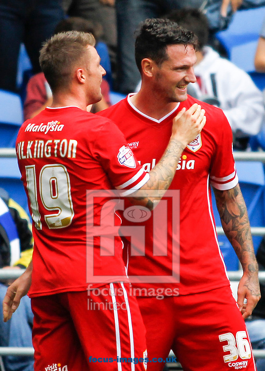 Sean Morrison (R) celebrates his goal with team mate Anthony Pilkington (L) of Cardiff City against Sheffield Wednesday during the Sky Bet Championship match at the Cardiff City Stadium, Cardiff<br /> Picture by Mike  Griffiths/Focus Images Ltd +44 7766 223933<br /> 27/09/2014