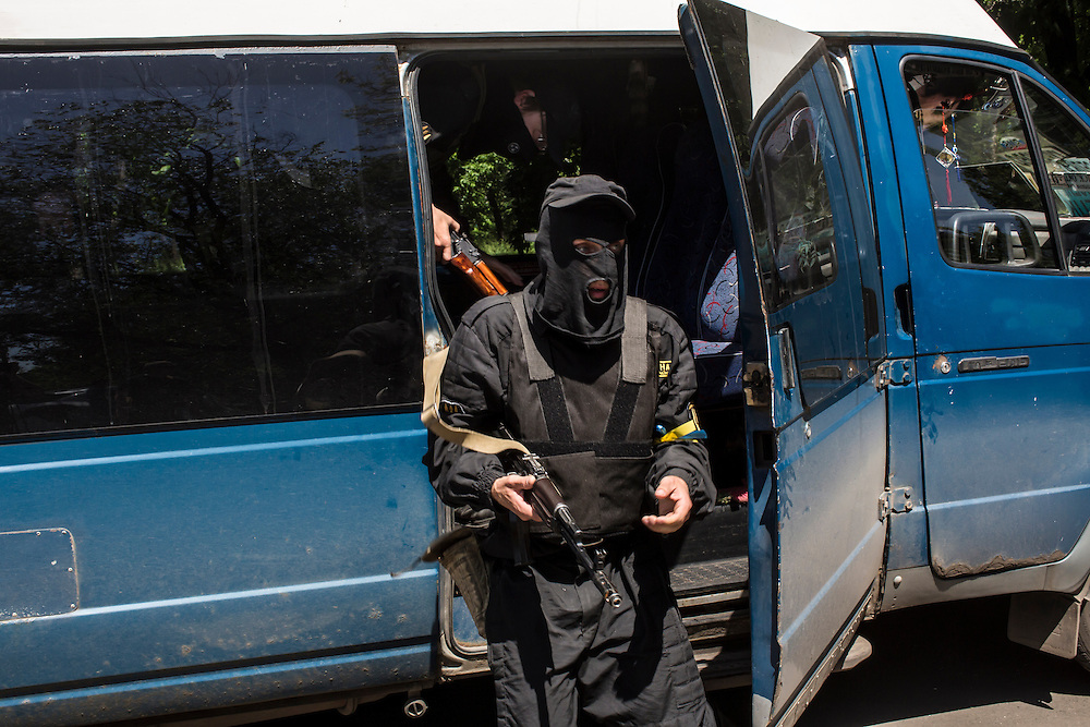 DOBROPILLYA, UKRAINE - MAY 21:  Members of the Donbass Battalion, a pro-Ukraine militia, arrive to meet with the head of the District State Administration to ensure the integrity of the upcoming presidential election on May 21, 2014 in Dobropillya, Ukraine. Days before presidential elections are scheduled, questions remain whether the eastern regions of Donetsk and Luhansk are stable enough to administer the vote. (Photo by Brendan Hoffman/Getty Images) *** Local Caption ***
