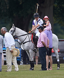 Prince William chats to a parent and their small child.<br /> Jerudong Trophy polo match at Cirencester Park, between Cirencester Purple and Cirencester Black,<br /> Gloucester, United Kingdom, Sunday July 14, 2013.<br /> Photo by:  i-Images