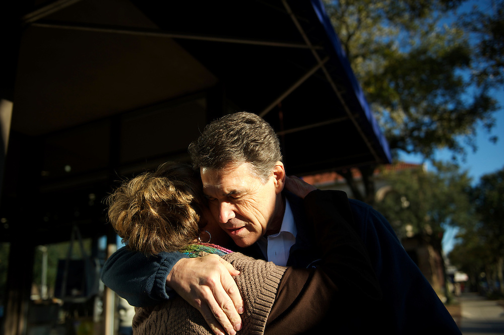 Republican Presidential candidate RICK PERRY embraces a supporter during a main street walk in Georgetown.  The South Carolina primary will be held on January 21st.