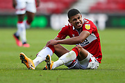 Middlesbrough forward Ashley Fletcher (11) sits on the turf, injured during the EFL Sky Bet Championship match between Middlesbrough and Bournemouth at the Riverside Stadium, Middlesbrough, England on 19 September 2020.