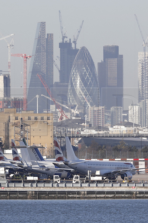 © Licensed to London News Pictures. 12/02/2018. London, UK. Royal Navy Bomb Disposal team arrives by boat at London City Airport which remains closed after a World War II era bomb was found in The River Thames during routine work on nearby King V Dock. Police have evacuated nearby residents, closed the airport and set up a 214-metre exclusion zone. Photo credit: Peter Macdiarmid/LNP