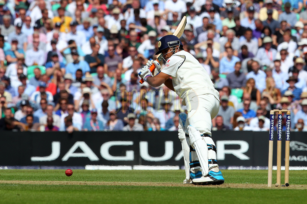 Mahendra Singh Dhoni captain of India during day one of the fifth Investec Test Match between England and India held at The Kia Oval cricket ground in London, England on the 15th August 2014<br /> <br /> Photo by Ron Gaunt / SPORTZPICS/ BCCI