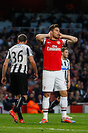 Olivier Giroud of Arsenal holds his hands on his head after a chance to take the lead is missed during the Barclays Premier League match at the Emirates Stadium, London<br /> Picture by David Horn/Focus Images Ltd +44 7545 970036<br /> 28/04/2014