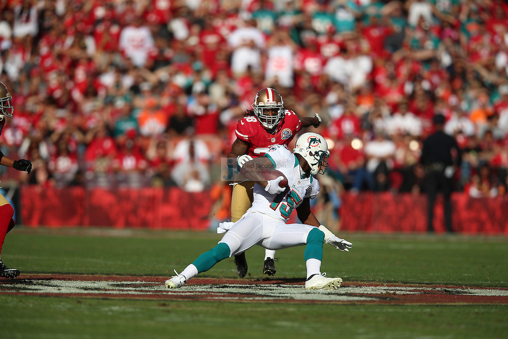 Miami Dolphins wide receiver Davone Bess (15) in action against the San Francisco 49ers during an NFL game at Candlestick Park on December 9, 2012 in San Francisco, CA.  (Photo by Jed Jacobsohn)