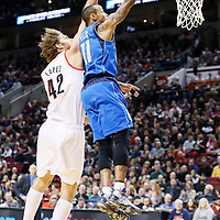 07 December 2013: Dallas Mavericks shooting guard Monta Ellis (11) goes for the layup past Portland Trail Blazers center Robin Lopez (42) during the Dallas Mavericks 108-106 victory over the Portland Trail Blazers at the Moda Center, Portland, Oregon, USA.