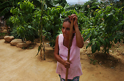 A Colombian woman stands outside her house near the border. He says he hasn't worked in 2 months.   There are about 2000 people seeking refugee status in Venezuela, most of whom are Colombians who have fled their country due to increasing violence caused by the conflict in Colombia.  Unable to return to Colombia for fear for their lives, and unable to obtain legal refugee status in Venezuela, many Colombian families live along the border.