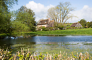 River Till seasonal chalk stream known as a winterbourne forming a pond, Orcheston, Wiltshire, England, UK
