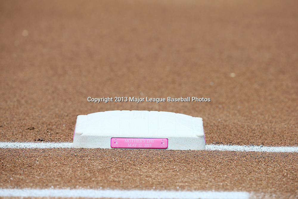 LOS ANGELES, CA - MAY 12:  First base features the date on a pink Mother's Day plaque in honor of Mother's Day before the Los Angeles Dodgers game against the Miami Marlins on Sunday, May 12, 2013 at Dodger Stadium in Los Angeles, California. The Dodgers won the game 5-3. (Photo by Paul Spinelli/MLB Photos via Getty Images)