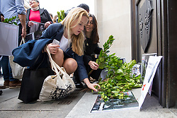 © Licensed to London News Pictures. 16/04/2018. London, UK. UK Bureau Director of Reporters Without Borders, Rebecca Vincent lays a laurel at a vigil outside the Malta High Commission to mark the six month anniversary of the murder of Maltese journalist Daphne Caruana Galizia. It is believed she was murdered due to her work as an investigative journalist. Demonstrators held bay leaves, as the name 'Daphne' is the personification of the laurel in Greek mythology. Photo credit : Tom Nicholson/LNP