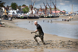 © Licensed to London News Pictures. 12/05/2019. Maldon, UK. A competitor nears the finish line as he takes part in the Maldon Mud Race in Essex. The race originated in 1973 and involves competitors racing around a course on the mudbanks of the river Blackwater at low tide. Photo credit: Peter Macdiarmid/LNP