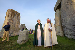 © Licensed to London News Pictures.21/06/2017. Stonehenge, Amesbury, Wiltshire, UK. ANETA KUCZNIER and MARK SEALY from the Glastonbury Druid Order Loyal Arthurian Warband, at the Summer Solstice celebrations at Stonehenge on the longest day of the year. Photo credit : Simon Chapman/LNP