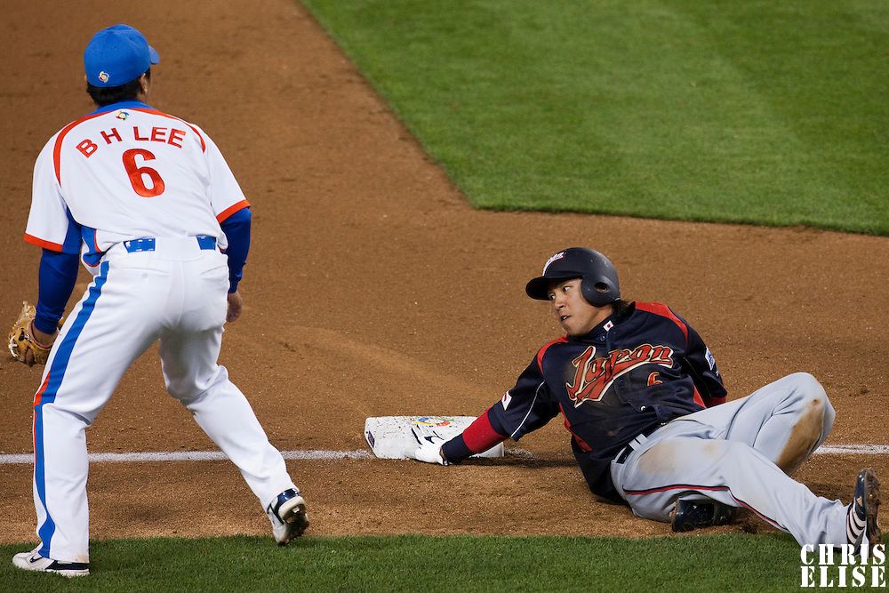 23 March 2009: #6 Hiroyuki Nakajima of Japan slides safely into third base over #6 Bum Ho Lee of Korea during the 2009 World Baseball Classic final game at Dodger Stadium in Los Angeles, California, USA. Japan defeated Korea 5-3