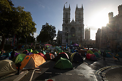 © Licensed to London News Pictures. 08/10/2019. London, UK. Extinction Rebellion protesters set up camp and block roads next to Westminster Abbey . Photo credit: George Cracknell Wright/LNP