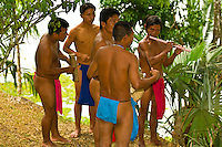 Embera Indian men in loin cloths play instruments in their village at Ellapuru, Chagres River, Soberania National Park (near the Panama Canal), Panama