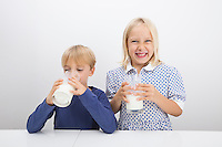 Children with glasses of milk at table