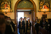 Students from Gonzaga Prep enter carying the cross and candles during a memorial for the former U.S. Speaker of the House, at St. Aloysius Church in Spokane, Wash. Friday November 1, 2013.  (Photo courtesyof Gonzaga University)