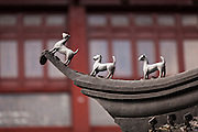 Roof charm statues on the Huxinting Teahouse in Yu Yuan Gardens Shanghai, China