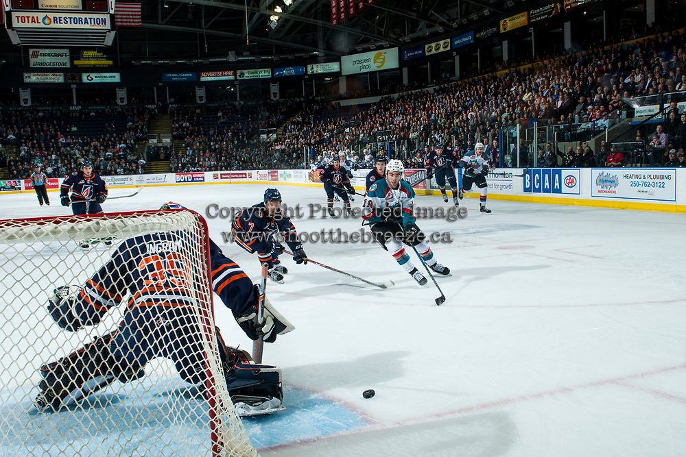 KELOWNA, CANADA - MARCH 31: Dillon Dube #19 of the Kelowna Rockets takes a shot on Connor Ingram #39 while being checked by Luke Zazula #7 of the Kamloops Blazers on March 31, 2017 at Prospera Place in Kelowna, British Columbia, Canada.  (Photo by Marissa Baecker/Shoot the Breeze)  *** Local Caption ***