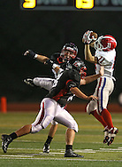 Washington's Noah Dostal (11) intercepts a pass as Linn-Mar's Nick Trabucco (28) and Max Kritzman (58) look on during the first quarter of the game between Cedar Rapids Washington and Linn-Mar at Linn-Mar Stadium in Marion on Friday, September 14, 2012.