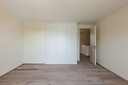 Interior of a new apartment, empty room with closet