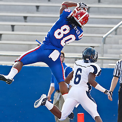 December 4, 2010; Ruston, LA, USA;  Louisiana Tech Bulldogs wide receiver Eric Harper (80) catches a touchdown over Nevada Wolf Pack cornerback Doyle Miller (6) during the first half at Joe Aillet Stadium.  Mandatory Credit: Derick E. Hingle
