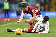 Nottingham Forest defender Tobias Figueiredo (3) fouls Aston Villa midfielder John McGinn (7) during the EFL Sky Bet Championship match between Aston Villa and Nottingham Forest at Villa Park, Birmingham, England on 28 November 2018.