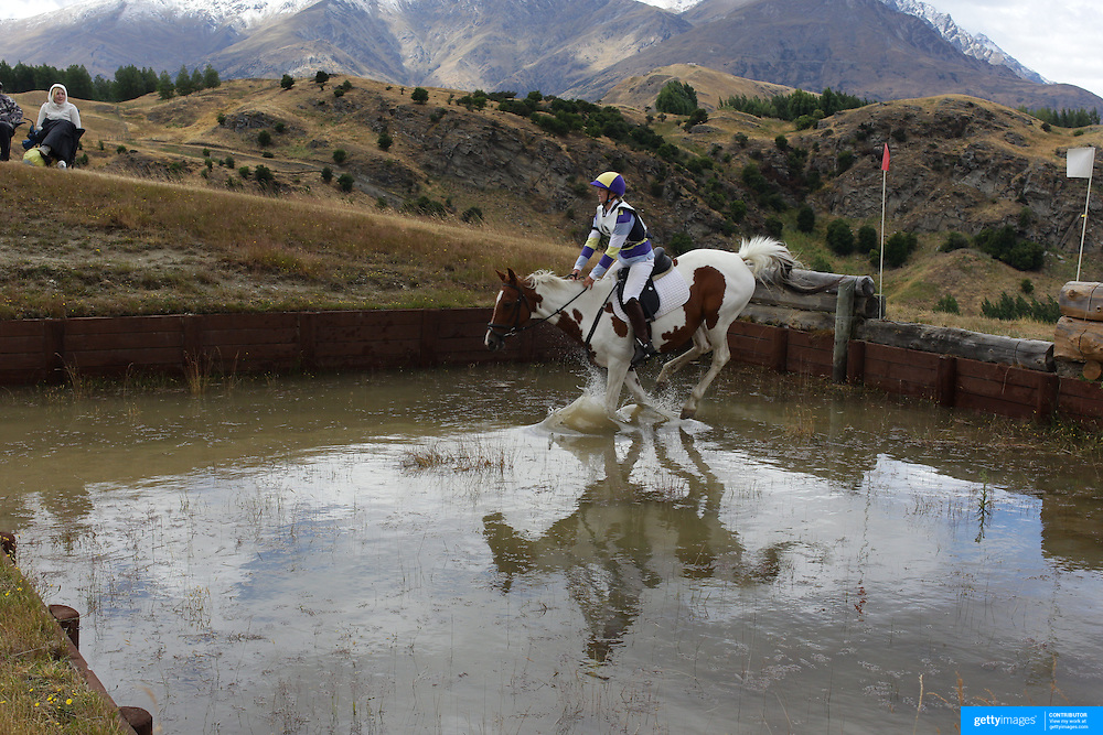 Grace Percy riding Zeffy in action at the water jump during the Cross Country event at the Wakatipu One Day Horse Trials at the Pony Club grounds,  Queenstown, Otago, New Zealand. 15th January 2012. Photo Tim Clayton