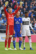 Cardiff City midfielder Aron Gunnarsson (17) Fulham goalkeeper Marcus Bettinelli (1) and Fulham midfielder Ryan Sessegnon (3) get set for a corner during the Premier League match between Cardiff City and Fulham at the Cardiff City Stadium, Cardiff, Wales on 20 October 2018.
