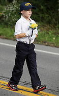 Salisbury Mills, New York - A boy marches down Route 94 with the Sparrowbush Fire Department during the Orange County Volunteer Firemen's Association (OCVFA) annual parade on Sept. 24, 2011.