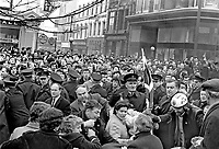 Police, RUC, Royal Ulster Constabulary, try to keep loyalist opponents of a N Ireland Civil Rights Association march apart in Londonderry on 29th March 1969. The civil rights march was the first that had been given permission to march within the Walled part of Londonderry. The march was very much opposed by Protestant Loyalists to whom the area within the City Walls is almost a shrine because of the famous Siege of Derry.  The picture includes Detective Inspector Cecil Patterson, who died in a Provisional IRA gun attack in Belfast on 26th February 1971 & Billy Flackes, BBC political editor, 196903290141<br /> <br /> Copyright Image from Victor Patterson, 54 Dorchester Park, Belfast, UK, BT9 6RJ<br /> <br /> t1: +44 28 9066 1296 (from Rep of Ireland 048 9066 1296)<br /> t2: +44 28 9002 2446 (from Rep of Ireland 048 9002 2446)<br /> m: +44 7802 353836<br /> <br /> e1: victorpatterson@me.com<br /> e2: victorpatterson@gmail.com<br /> <br /> The use of my copyright images is subject to my Terms & Conditions.<br /> <br /> It is IMPORTANT that you familiarise yourself with them. They are available on my website at www.victorpatterson.com.<br /> <br /> None of my copyright images may be used on a website unless they are visibly watermarked, i.e. © Victor Patterson within the body of the visible image. Metadata denoting my copyright must NOT be deleted. <br /> <br /> Web use (maximum size - 300 kb) is extra at currently recommended NUJ rates.