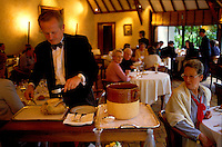 Bernard Loiseau's Hotel-Restaurant C(TM)te d'Or, Saulieu, Burgundy, 2000 - Maitre d'Hotel Hubert carves one of Loiseau's signature dishes, a truffles, steamed Bresse Chicken.© Owen Franken