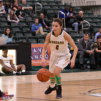 2nd year guard Avery Pearce (4) of the Regina Cougars in action during the home opener  on November  4 at Centre for Kinesiology, Health and Sport. Credit: /Arthur Images