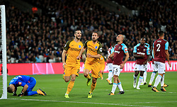 Brighton & Hove Albion's Glenn Murray celebrates scoring his side's first goal of the game with teammate Shane Duffy during the Premier League match at the London Stadium.