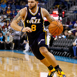December 17, 2010; New Orleans, LA, USA; Utah Jazz point guard Deron Williams (8) against the New Orleans Hornets during the first half at the New Orleans Arena.  Mandatory Credit: Derick E. Hingle