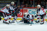 KELOWNA, BC - JANUARY 4:  Liam Kindree #26 clears the puck away from the net of Roman Basran #30 of the Kelowna Rockets after a shot by Alex Kannok Leipert #41 of the Vancouver Giants during first period at Prospera Place on January 4, 2020 in Kelowna, Canada. (Photo by Marissa Baecker/Shoot the Breeze)