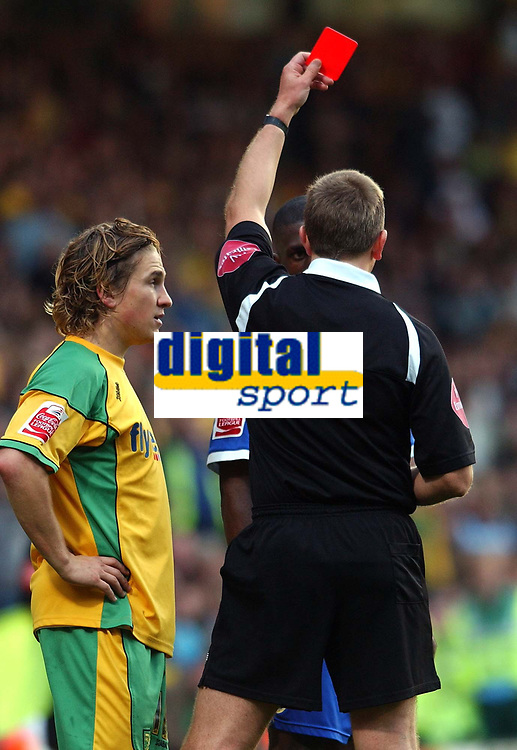 Photo: Ashley Pickering.<br />Norwich City v Cardiff City. Coca Cola Championship. 21/10/2006.<br />Cardiff's Kerrea Gilbert (blue) is sent off after a kick on Norwich's Paul McVeigh (yellow).