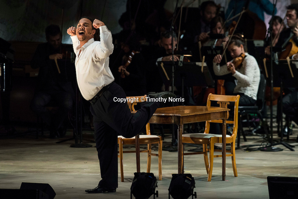 """Aubrey Allicock (bass-baritone) as """"Tonic"""" in the world premiere of Steven Stucky and Jeremy Denk's The Classical Style: An Opera (of Sorts) at the 68th Ojai Music Festival at Libbey Bowl on June 13, 2014 in Ojai, California."""