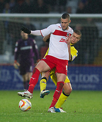 STEVENAGE, ENGLAND - Saturday, November 24, 2012: Tranmere Rovers' Ben Gibson in action against Stevenage's Greg Tansey during the Football League One match at Broadhall Way. (Pic by David Rawcliffe/Propaganda)